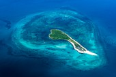 Coral island with surrounding atoll, aerial photograph