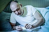 Man taking sleeping pills