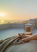 Barefoot woman enjoying scenic sunset ocean view