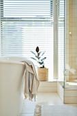 Towel hanging over soaking tub