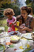 Mother and daughters enjoying summer barbecue