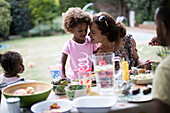 Mother and daughter enjoying backyard barbecue
