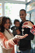 Family receiving new house keys from realtor
