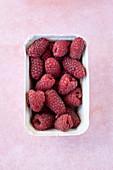 Raspberries in a paper box