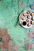 Sushi with avocado, smoked salmon and umeboshi plum