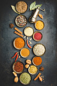 Various bowls of spices on dark background