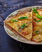 Three cheese pizza with basil