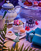 Festively decorated table with cupcakes and gifts