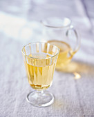 White wine in a glass and pitcher