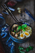 Asian noodle soup with chicken and quail egg