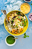 Samosa chaat with chickpeas curry, yogurt and chutney