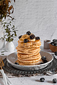 Dairy free whole wheat pancakes served with honey, banana and berries
