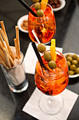 Aperitif with Aperol Spritz, olives and grissini