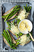Asparagus spears and grated cheese on wholegrain sourdough bread
