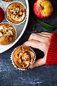 Woman holding an apple cinnamon muffin