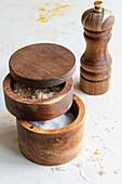 Various types of salt in wooden jars