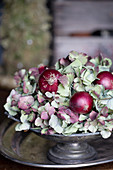 Red onions and hydrangea blossoms in a pewter bowl
