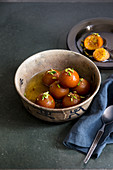 Indian dessert - Gulab Jamun with sweet sugar syrup and chopped pistachios