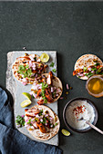 Traditional Mexican chicken tacos with jalapenos and fresh coriander