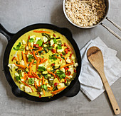 Vegan oven-baked curry with banana and peanut sauce