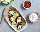 Baked cauliflower with a tomato crust and yoghurt dip