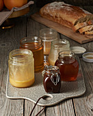 Different kinds of honey in jars on a breakfast table