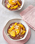 Vegan chocolate chia pudding with oranges and almonds