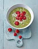 Green Smoothie Bowl with raspberries and coconut