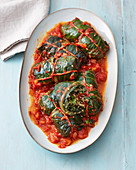 Vegan chard parcels with quinoa in tomato sauce