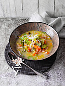 Vegan winter soup with pearl barley