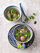 Asian spice broth with ginger meatballs