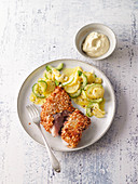 Baked fish with cucumber and potato salad and mustard dip