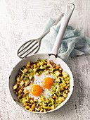 Leek and potato breakfast with fried eggs