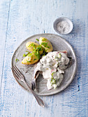 Herring in cucumber-radish sour cream with baked potatoes