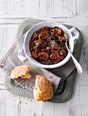 Beef casserole with red cabbage and mushrooms