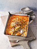 Brussel sprouts and fish casserole with potato topping