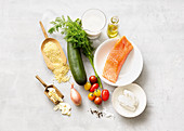 Ingredients for salmon with millet and zucchini-tomato chunks