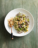 Vegan shiitake stew with savoy cabbage and millet