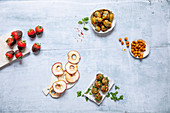 Healthy snacks: chocolate strawberries, apple rings, olives, curried chickpeas, tomato cakes