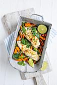 Fisch mit Nusskruste auf Gemüse