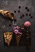Pink ice cream scoop and waffle cone with flowers