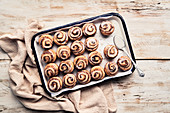 Glazed cinnamon rolls on baking tray