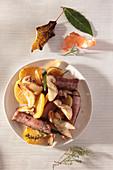 Salsiccia with roast potatoes and porcini mushrooms