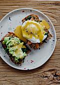 Ooen breakfast sandwich with avocado, eggs and Hollandaise