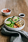 Sushi bowl with edamame and omelette