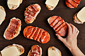 Pieces of bread with ham, salami and cheese