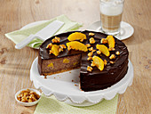 Chocolate cheesecake with orange and peanuts