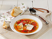 Clear tomato soup with chicken fillet