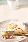A piece of pear crostata with almonds
