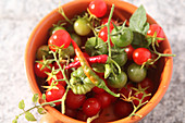 Vine tomatoes and chilli peppers in a small bowl